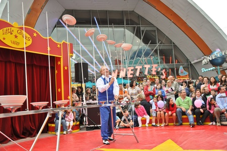 disneyland paris, august, 13, 2010 - disney village,  little circus entertainment juggler with dishes in disney village out of disneyland paris