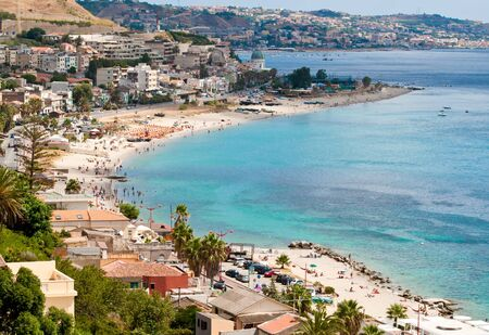 beach crowded with wet on the coast of the strait of messina photo