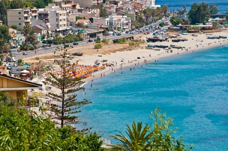 beach crowded with wet on the coast of the strait of messina