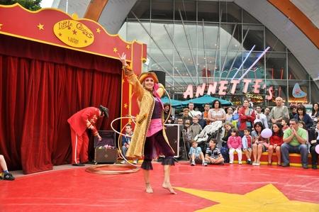 disneyland paris, august, 13, 2010 - disney village,  little circus entertainment hola hoop dancer in disney village out of disneyland paris