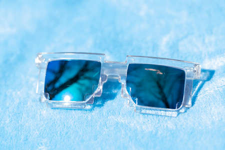 Pixel sunglasses design with green lenses shoot in a summer day closeup. Selective focus
