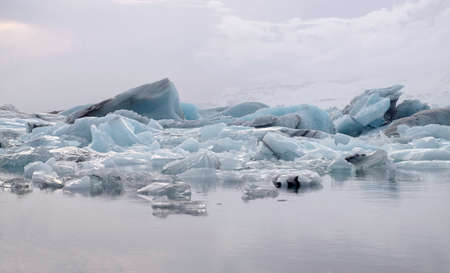 Glacial ice blocks in calm water in Jokulsarlon lake, Iceland