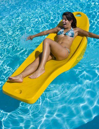 felice: Relax in Piscina Stock Photo