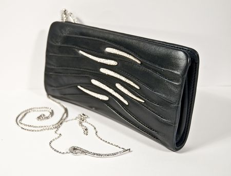 pochette:   Pochette in black on a white background and coordinated necklace  Stock Photo