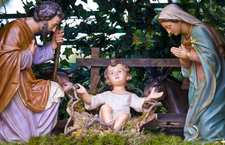 statues of the Holy Family in a crib photo