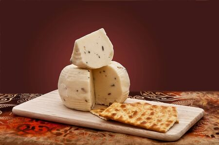 Truffle cheese and crackers on a cutting board Stock Photo - 6567434