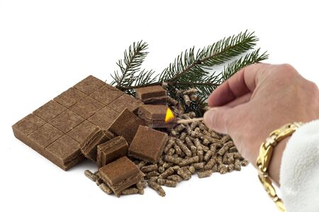 fireplace lighter: ecological materials for heating on white background  Stock Photo