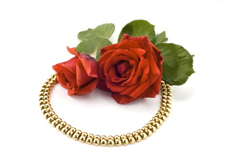 necklace and red rose on white background photo