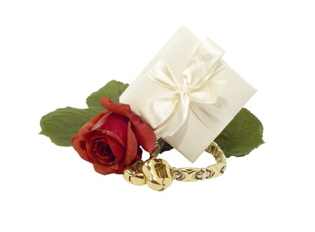 Jewelry gold with red rose on white background photo