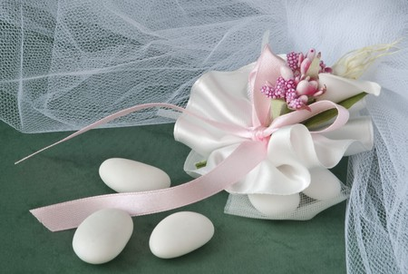 candy wedding favors and packaging materials on a green background photo