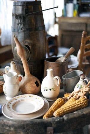 old items: small exhibition of antiques on blurred background Stock Photo