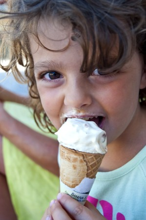 Close up of a girl who is eating an ice cream