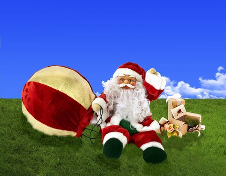 Santa Claus doll with balloon on a white background photo