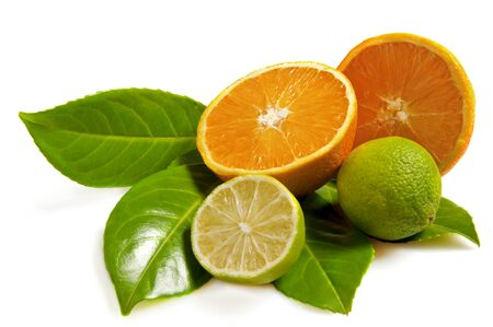Lime, orange and leaves on white background