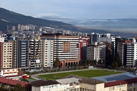 The modern city of Quito, with its skyscrapers and soccer field