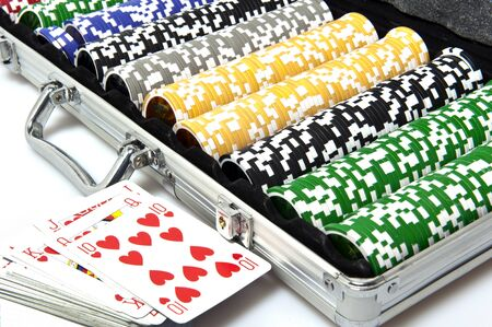 metal briefcase with fisches for the game of poker photo
