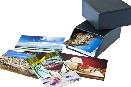 Business cards and container on white background