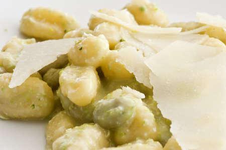 plate of potato gnocchi with pesto and shavings parmesan  photo