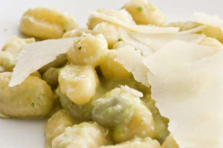 plate of potato gnocchi with pesto and shavings parmesan  photo