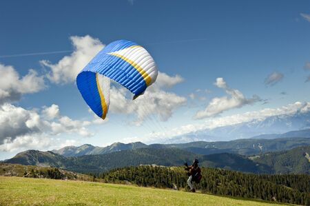 trentino: Paraglider flying over the Alps of Trentino Stock Photo