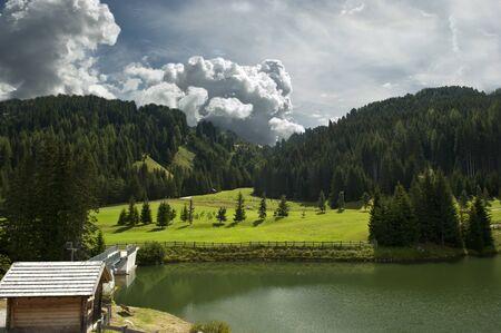 the small alpine lake of the Italian Dolomites photo