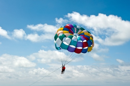 Paragliding pulled by a motorboat on the beachof 'equator Stock Photo - 11971987