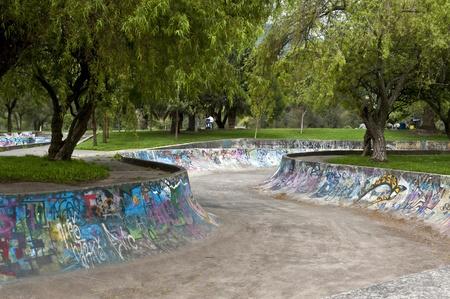 quito: Skateboarding with graffiti in the public gardens in Quito
