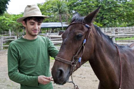 Horses and riders on a farm in Ecuador Stock Photo - 12351923