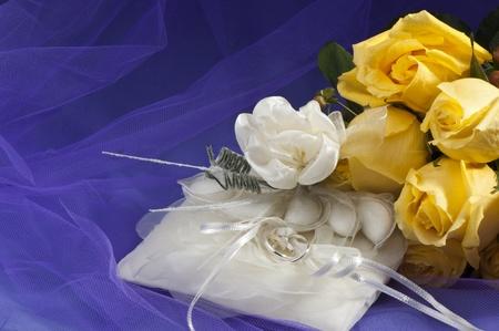 wedding favors: wedding ring ,wedding favors and yellow roses