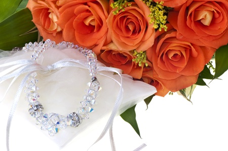 necklace and orange roses on a white background Stock Photo - 12511653