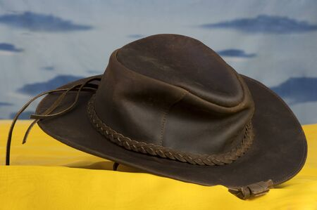 A hat with leather in typical Western style