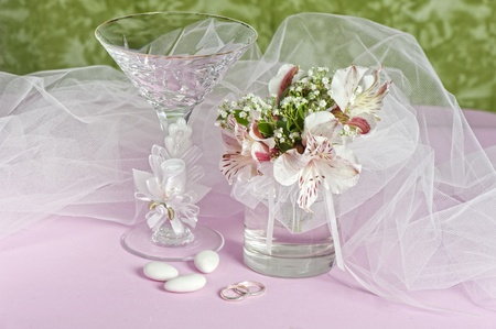 Arrangement with flowers and favors for wedding, baptismand First Communion photo