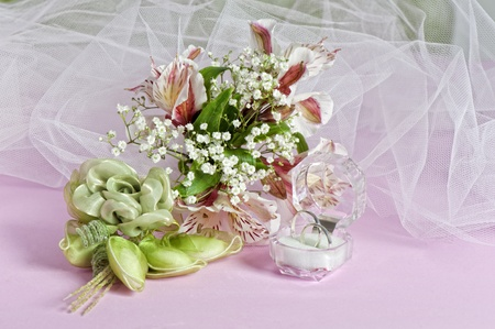 Arrangement with flowers and favors for wedding, baptism and First Communion photo