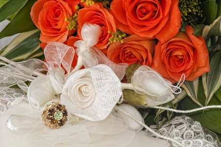 Arrangement with flowers and wedding rings photo