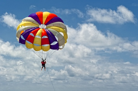 parasailing: Paragliding pulled by a motorboat on the beachof
