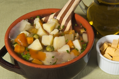 rustic soup with mixed vegetables and pumpkin photo