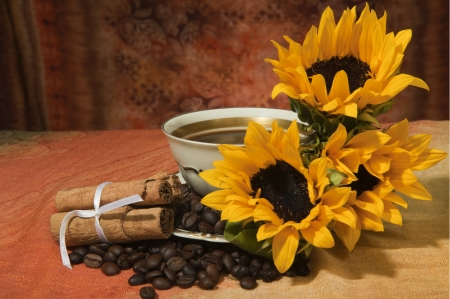 cup with coffee beans and sunflowers on a colored background photo