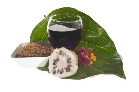 morinda: morinda citrifolia juice on a  white background Stock Photo