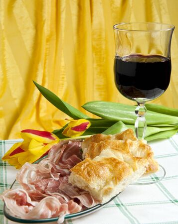 italian sausage: Typical Italian sausage sliced cake and flowers Stock Photo