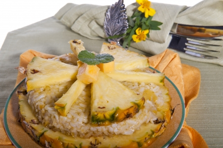 Rice pudding with pineapple on a green background photo