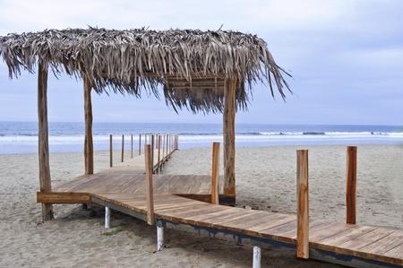 wooden bridge on a beach in Ecuador Stock Photo - 17299963