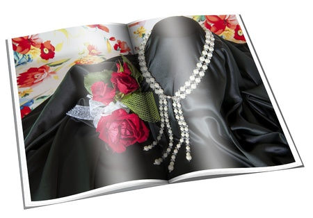 read magazine: Newspaper with pictures of necklace on white background