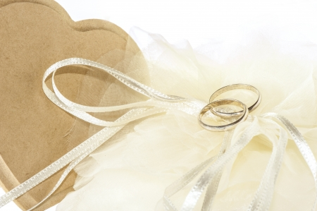 wedding favor: wedding favors and wedding rings on white background Stock Photo