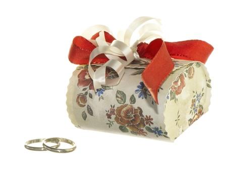wedding favors: wedding favors and wedding rings on white background Stock Photo