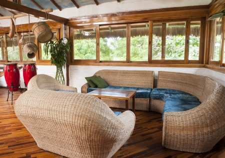 living room sofa: A living room in bamboo in a house in Ecuador