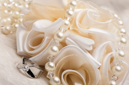 wedding favors and wedding ring on on colored background photo
