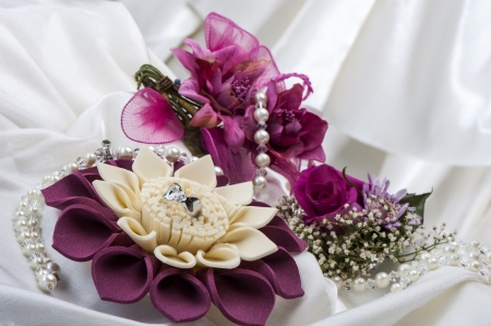 flowers and wedding rings on white background photo
