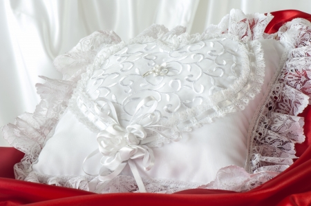 whitw: a whitw pillow for a wedding rings Stock Photo