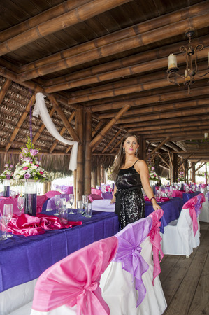 a women wedding planner on the beach in Ecuador photo
