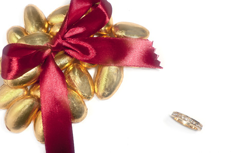 a isolated  wedding rings and satin bow  photo
